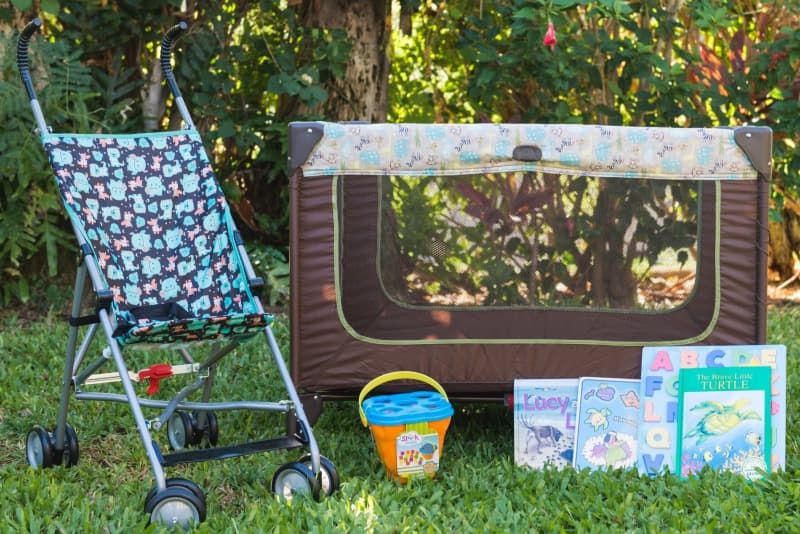 Baby gear by Maui vacation rental company Coconut Condos - stroller, playpen, baby books, puzzles, and sand toys