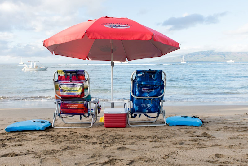 Tommy Bahama beach chairs and umbrella on the beach in Lahaina, Maui, Hawaii