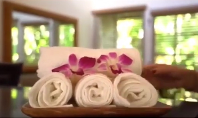 Cold towels with an orchid bloom provided by Coconut Condos for their Maui vacation rental guests