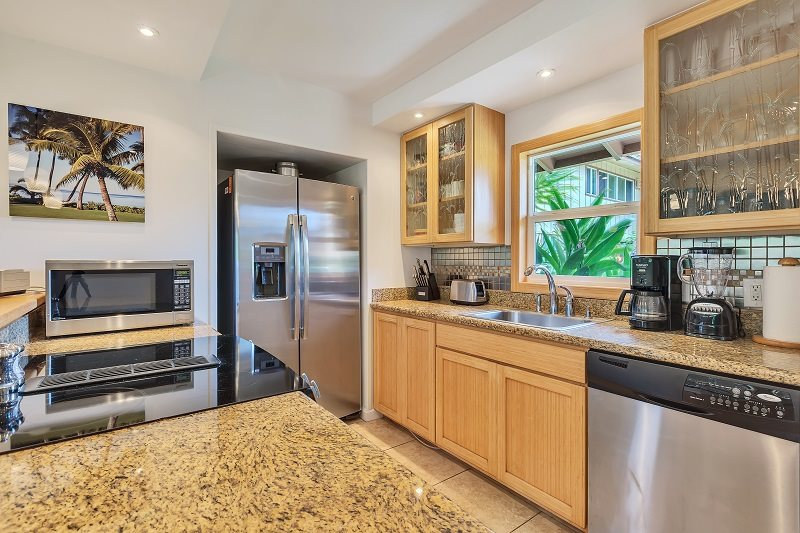 Maui vacation rental condo kitchen, fully shocked with modern appliances, cookware, dishes, silverware