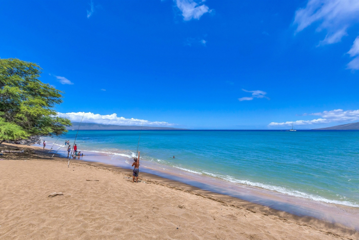 Kahana Beach, Maui, kids fishing at the beach.